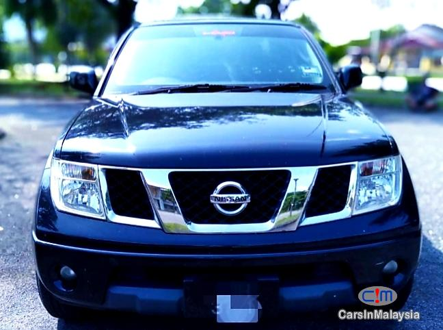Pictures of Nissan Navara 2.5-LITER DISEL TURBO 4X4 6 SPEED Manual 2013
