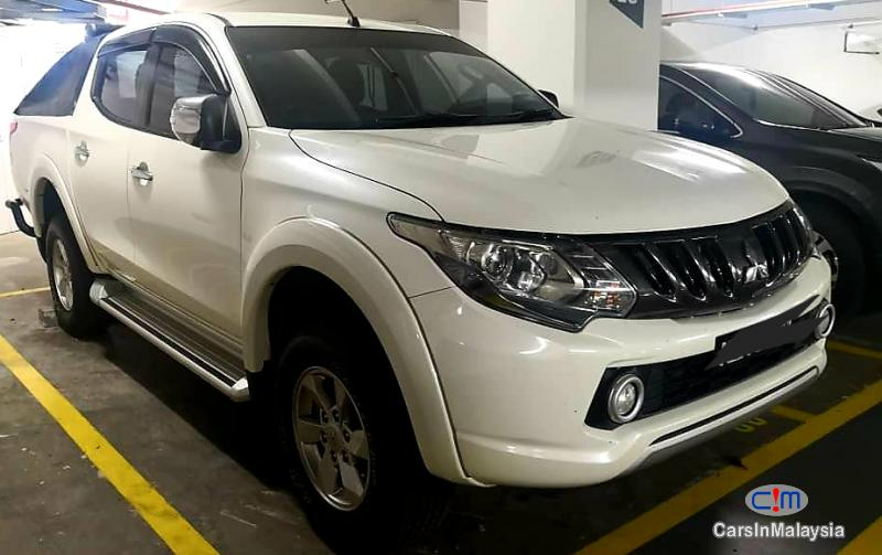 Pictures of Mitsubishi Triton 2.5-LITER 4x4 DOUBLE CAB DIESEL TURBO Automatic 2007