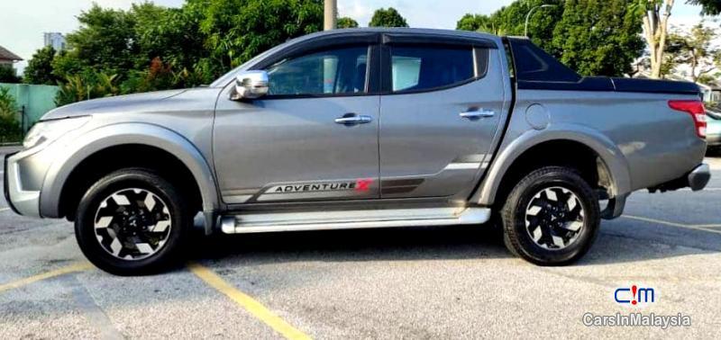 Mitsubishi Triton 2.4-LITER 4WD DOUBLE CAB 4X4 DIESEL TURBO Automatic 2017 in Malaysia