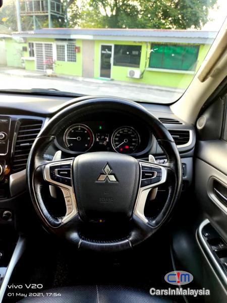 Mitsubishi Triton 2.4-LITER 4WD DOUBLE CAB 4X4 DIESEL TURBO Automatic 2017 in Selangor - image