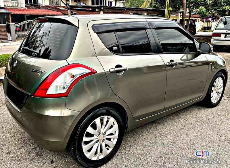 Pictures of Suzuki Swift 1.4-LITER ECONOMY HATCHBACK Automatic 2015