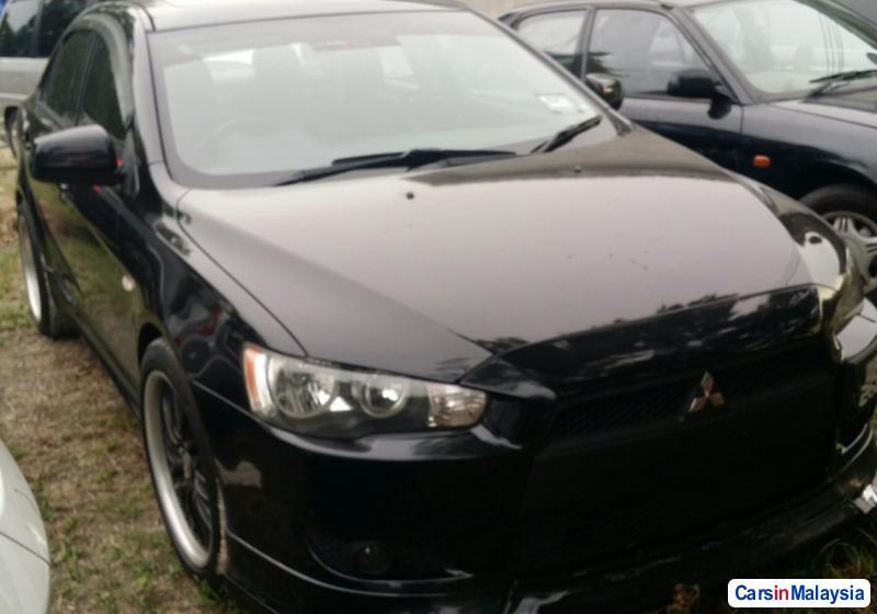 Pictures of Mitsubishi Lancer 2.0-LITER LUXURY SEDAN Automatic 2012